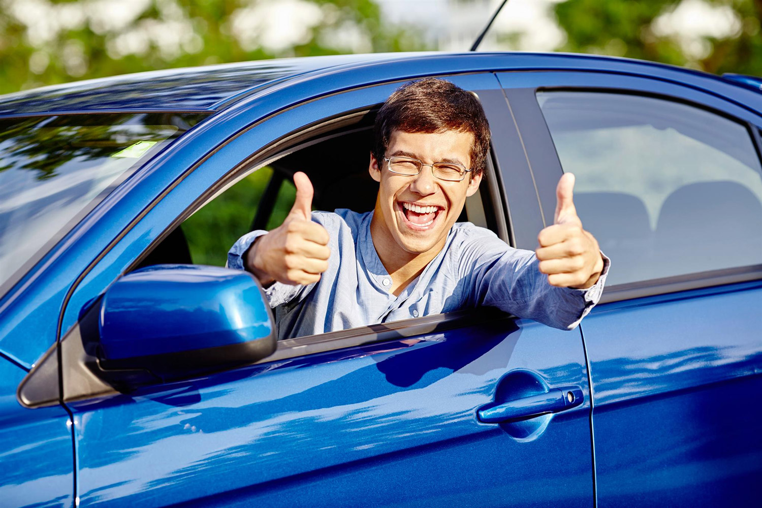 A young adult celebrates passing their driving test