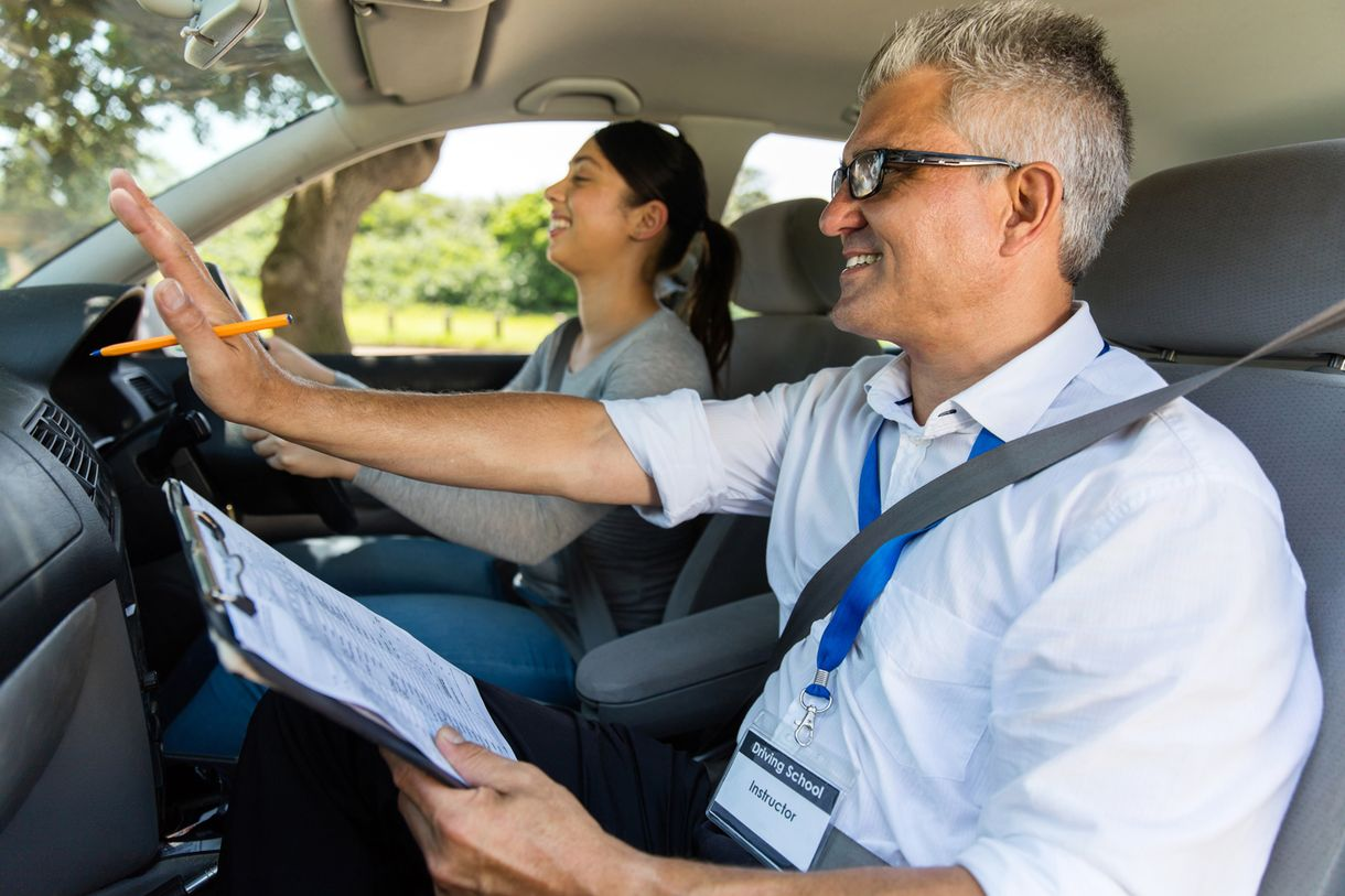 A instructor giving pointer to a learner driver